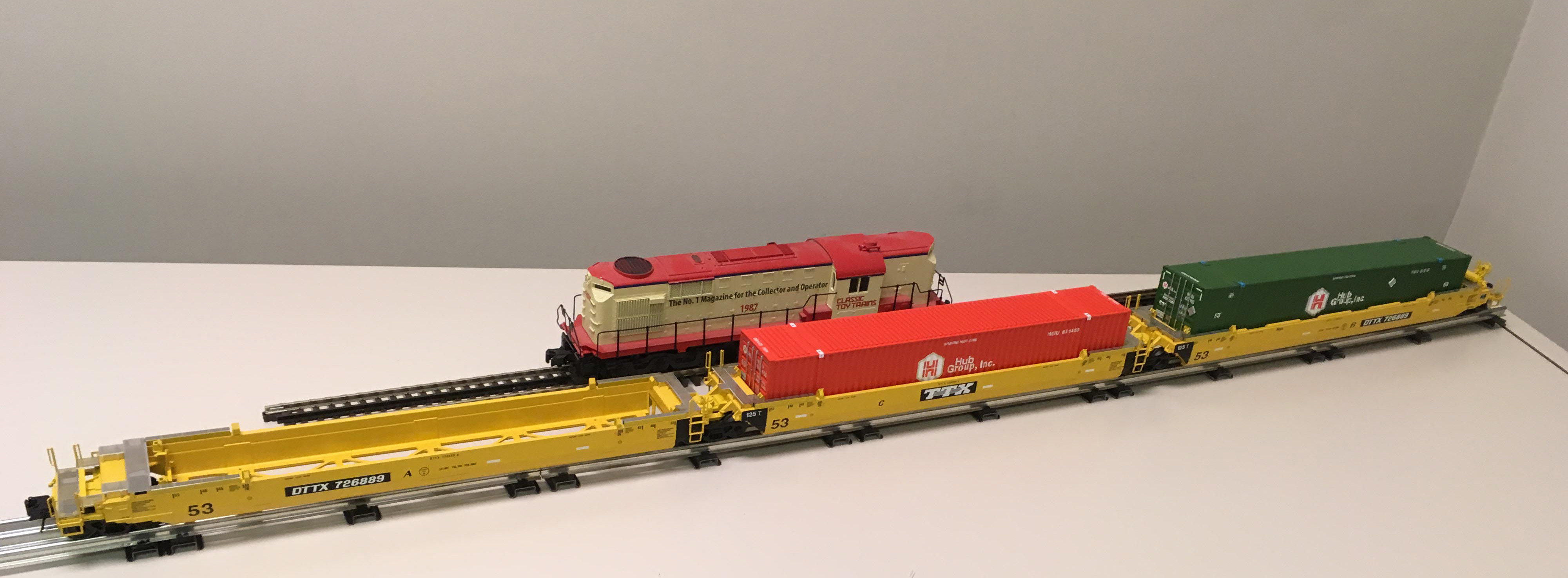 New well cars from atlas o classic toy trains magazine for Atlas car aluminium
